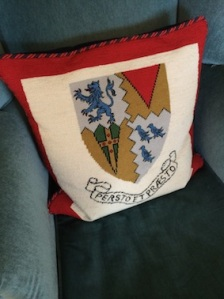 The school crest on the cushion