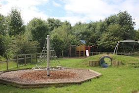 Past the play area on the left
